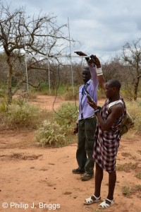 Assistant Program Manager Richard Morinke teaching Darem how to use a telemetry receiver.