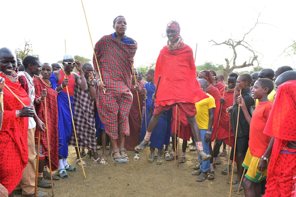 Gwagi on the left and Noah on the right demonstrating their different styles to the great delight of the bystanders.