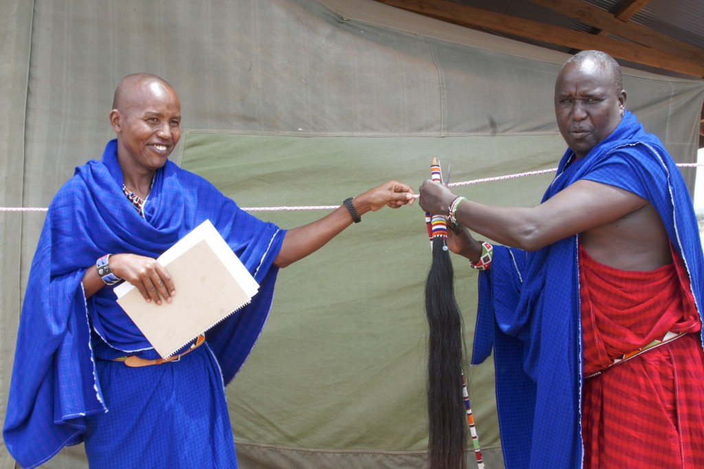 Chief Leturesh cuts the ribbon and officially declares the camp open