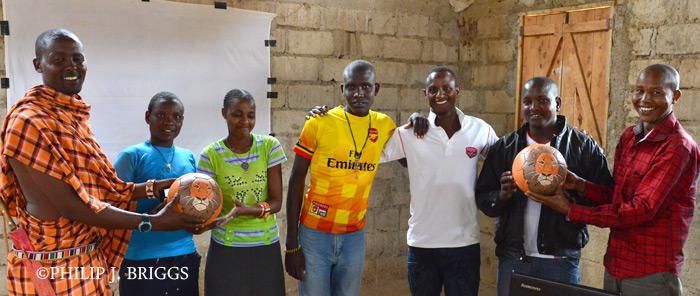 Eric-presents-football-to-community-football-team_PBP_7220